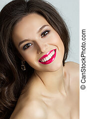Portrait of beautiful smiling brunet woman