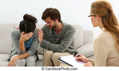 Young unhappy couple talking with therapist - Young unhappy...