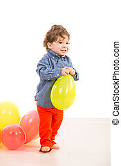 Toddler walking with balloon - Toddler boy walking and...