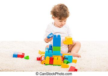 Toddler boy playing on carpet - Toddler boy playing with...