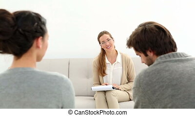 Therapist smiling at reconciled co - Therapist smiling at...