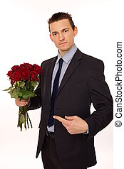 Young man with red roses