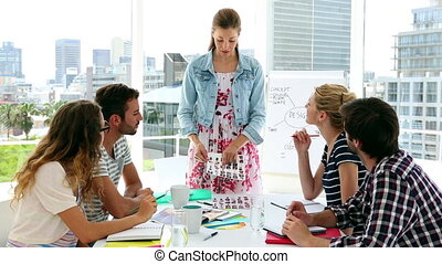 Team of designers having a meeting in creative office