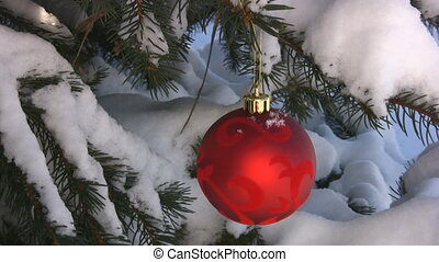 Christmas Decoration Hanging On A Snow Covered Tree
