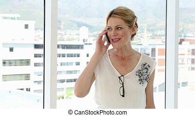 Happy businesswoman dancing after a