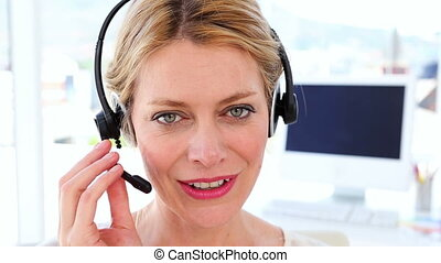 Happy call center agent on a call - Happy call center agent...