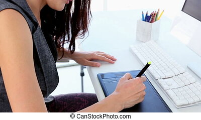 Graphic designer working on digiti - Graphic designer...