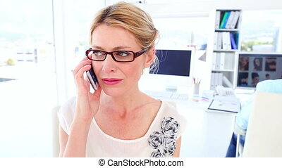 Disappointed businesswoman on the phone in her office