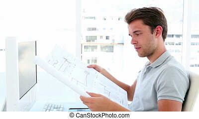Architect working at his desk - Architect working at his...