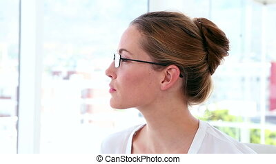 Businesswoman thinking at her desk - Businesswoman thinking...