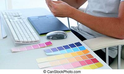 Graphic designer looking at colour - Graphic designer...
