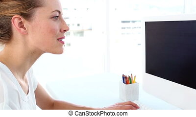 Pretty graphic designer using digitizer in her office