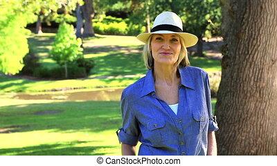 Smiling woman looking at camera - Smiling woman looking at...