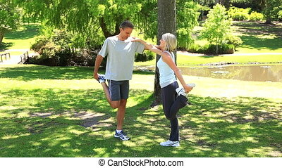 Couple stretching together in the park