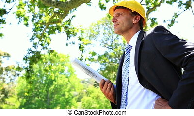 Architect envisioning his plans - Architect envisioning his...