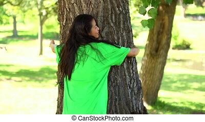 Happy activist hugging a tree - Happy environmental activist...