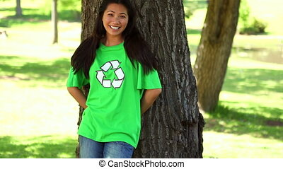 Activist leaning against a tree - Happy environmental...