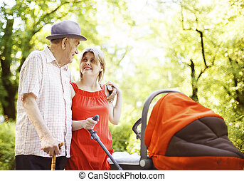 Three Generations - Happy family in the park. Grandfather,...