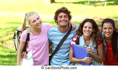 Happy students smiling at camera