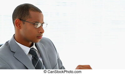 Businessman thinking at his desk in his office