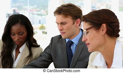Business people discussing their w - businessman, corporate,...