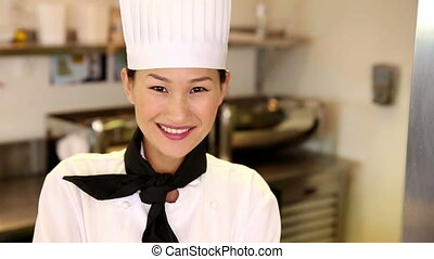 Happy chef smiling at camera giving thumbs up in commercial...