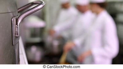 Chefs working at the order station - Team of chefs working...