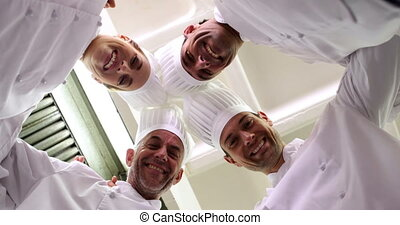 Chefs standing in circle - Team of chefs standing in circle...