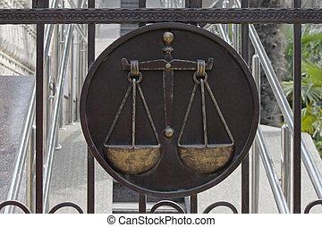sign of jurisprudence on door of court