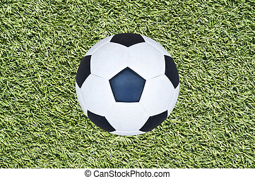 Soccer ball on grass field.