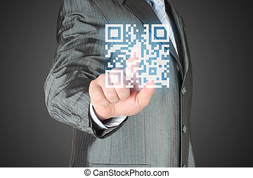 Businessman with hand pressing virtual qr code - Businessman...