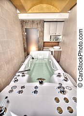 Jacuzzi Spa Bathtub in a marble bathroom