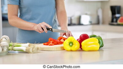Woman preparing vegetables on the cutting board