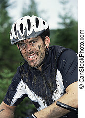 Mountain biker covered in mud