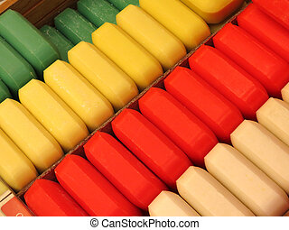 All-Natual Soaps - Rows of colourful bars of soap made with...