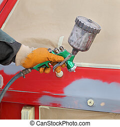 Car painting - Car ready for repaint, worker hand and car...