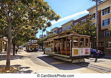 cable car - SAN FRANCISCO, CA - AUGUST 17: Passengers ride...