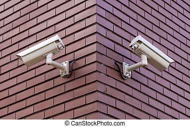 Security cameras - Two security cameras on the brick wall...