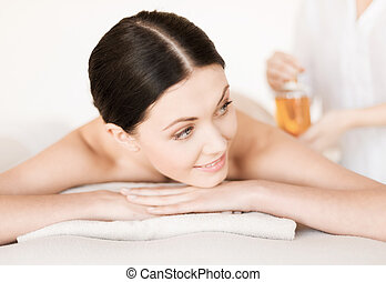 woman in spa - picture of woman in spa salon getting oil...