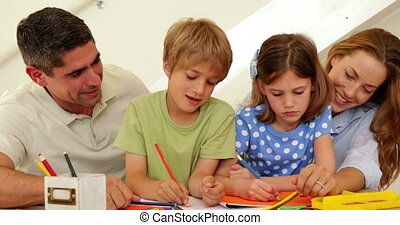 Happy parents and children drawing together at home in...