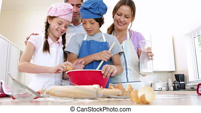 Happy family baking together at home in the kitchen