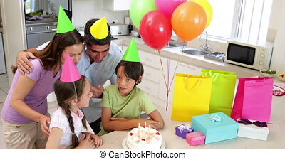 Happy family celebrating a birthday together at home in the...
