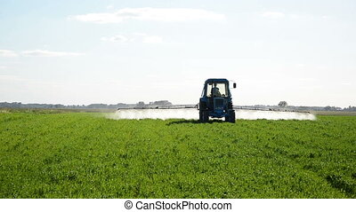 tractor fertilize field - Tractor spray fertilize field with...