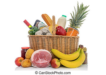 Wicker basket full of food groceries isolated on white