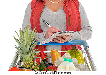 Woman checking her food shopping list - A woman checking her...