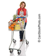 Woman food shopping with trolley isolated - A woman with a...