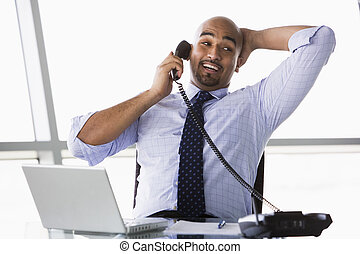 Businessman taking phone call - Businessman taking call in...