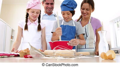 Cute family baking together at home in the kitchen