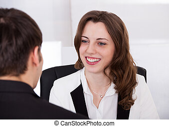 Businesswoman Looking At Candidate During Interview -...
