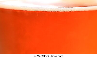 Beer Bubbles - A close up of carbonation in a light amber...